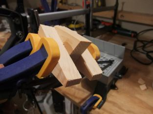 Clamping jig piece. You can see the angle that it holds the wood being sawed at 22.5 degrees