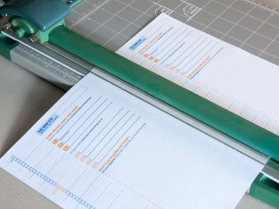 My trusty paper cutter helped me align the cutting point at 5.5 inches exactly.